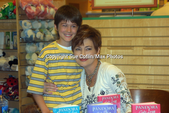 """A fan with Carolyn Hennesy """"Diane Miller"""" - GH at Barnes and Noble on May 19, 2009 with her new book Pandora Gets Lazy - the third book in a series of 7. They are based on the Seven Deadly Sins. (Photo by Sue Coflin/Max Photos)"""