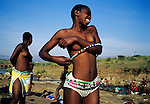 NONGOMA, SOUTH AFRICA - SEPTEMBER 11: Nobule Ngema, age 16, dress after taking a traditional bath in a river during the annual Reed Dance on September 11, 2004 in Nongoma in rural Natal, South Africa. Nobuhle traveled on a bus and about 20.000 fellow maidens from all over South Africa is came to dance for Zulu King Goodwill Zwelethini at the Enyokeni Royal Palace in Kwa-Nongoma about 350 kilometers from Durban. The girls come to the kingdom to declare their virginity and the ceremony encourages girls and young women to abstain from sexual activity to curb the spread of HIV-Aids. Its Nobuhle's first trip and she's already has three virginity certificates as she was tested in the village for the last three years. .(Photo: Per-Anders Pettersson)......