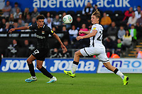 Shaun McWilliams of Northampton Town vies for possession with George Byers of Swansea City during the Carabao Cup First Round match between Swansea City and Northampton Town at the Liberty Stadium in Swansea, Wales, UK. Tuesday 13 August 2019