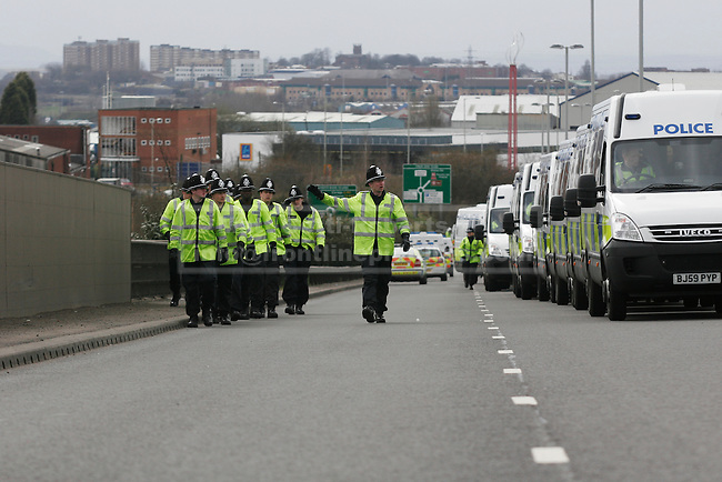 With the march about to begin, extra police arrive to marshall the cordon area.
