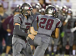 Torrance, CA 09/25/15 - Jeremiah Aiono (Torrance #28) and Ryan Carroll (Torrance #2) in action during the El Segundo - Torrance varsity football game at Zamperini Field of Torrance High School
