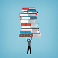 Man holding large pile of books above his head