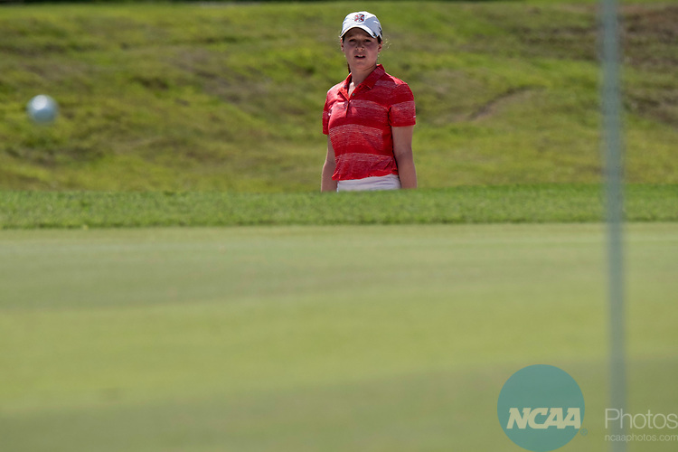 HOUSTON, TX - MAY 12: Nikki Isaacson of Rhodes College watches her ball roll towards the hole during the Division III Women's Golf Championship held at Bay Oaks Country Club on May 12, 2017 in Houston, Texas.  Isaacson tied for second place overall and helped Rhodes College win the DIII National Championship with a team score of 1297. (Photo by Rudy Gonzalez/NCAA Photos/NCAA Photos via Getty Images)