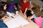 Public elementary school for the gifted grades K-6: male student taking the lead in graphing activity