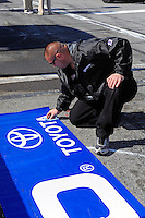 14 February, 2010, Daytona Beach, Florida USA USA.Cleaning the Toyota logo on a pit wall banner..©F. Peirce Williams 2010 USA.