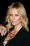 """BEVERLY HILLS, CA. - September 22: Actress Charlize Theron arrives at a special screening of """"Battle in Seattle"""" held at the Clarity Theater on Monday September 22, 2008 in Beverly Hills, California.(Photo by Jeffrey Mayer/WireImge) *** Local caption ***"""