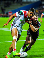 Kieran Foran tries to stop Nene MacDonald during the NRL Premiership match between the NZ Warriors and St George-Illawarra Dragons at FMG Stadium, Hamilton, New Zealand on Friday, 19 May 2017. Photo: Dave Lintott / lintottphoto.co.nz