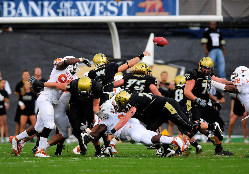 04 October 2008: Colorado quarterback Cody Hawkins passes the ball under pressure as a crowd of Texas defenders and Colorado linemen pile up around him. The Texas Longhorns defeated the Colorado Buffaloes 38-14 at Folsom Field in Boulder, Colorado. For Editorial Use Only