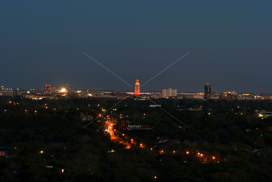 The University of Texas Tower is light orange with No. 1 to showcase a National Champsionship win
