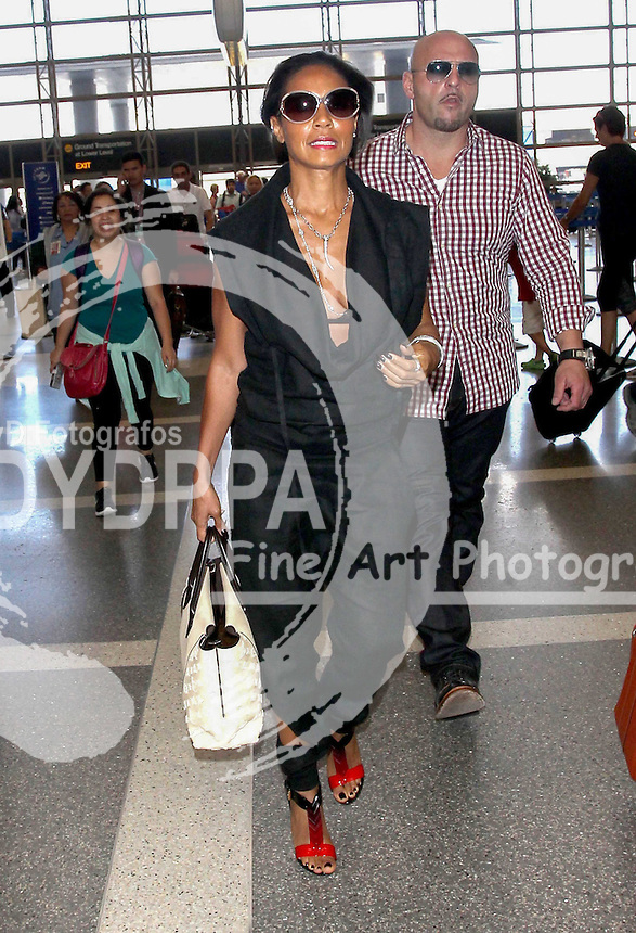 **ALL ROUND PICTURES FROM SOLARPIX.COM**<br /> **SYNDICATION RIGHTS FOR UK, AUSTRALIA, DENMARK, PORTUGAL, S. AFRICA, SPAIN &amp; DUBAI (U.A.E) &amp; ASIA (EXCLUDING JAPAN) ONLY**<br /> Caption:<br /> Jada Pinkett Smith Sighted at LAX Airport in  Los Angeles.<br />  <br /> This pic:Jada Pinkett Smith <br /> JOB REF:18333  PHZ/STPR   DATE:26.06.15<br /> **MUST CREDIT SOLARPIX.COM OR DOUBLE FEE WILL BE CHARGED**<br /> **MUST AGREE FEE BEFORE ONLINE USAGE**<br /> **CALL US ON: +34 952 811 768 or LOW RATE FROM UK 0844 617 7637**