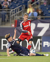 New England Revolution midfielder Pat Phelan (28) slide tackles attacking Toronto FC midfielder Gianluca Zavarise (28). In a Major League Soccer (MLS) match, the New England Revolution tied Toronto FC, 0-0, at Gillette Stadium on June 15, 2011.