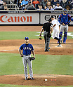 Yu Darvish (Rangers),<br /> JUNE 25, 2013 - MLB :<br /> Yu Darvish of the Texas Rangers reacts after giving up a home run to Brett Gardner of the New York Yankees, crossing home plate, in the fifth inning during the Major League Baseball game at Yankee Stadium in The Bronx, New York, United States. (Photo by AFLO)