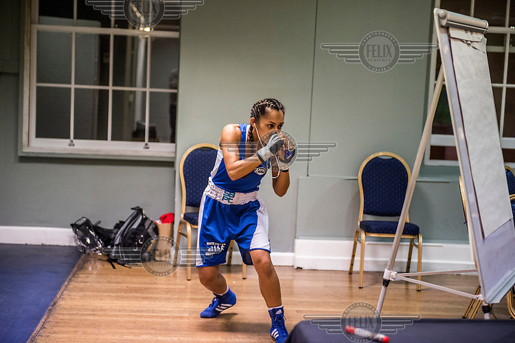 Harvinder Jutte, a female 'white collar boxer', prepares for her fight at the 'Carpe Diem' event at London Irish Centre. <br /> <br /> 'White-collar boxing' is a growing phenomenon amongst well paid office workers and professionals and has seen particular growth in financial centres like London, Hong Kong and Shanghai. It started at a blue-collar gym in Brooklyn in 1988 with a bout between an attorney and an academic and has since spread all over the world. The sport is not regulated by any professional body in the United Kingdom and is therefore potentially dangerous, as was proven by the death of a 32-year-old white-collar boxer at an event in Nottingham in June 2014. The London Irish Centre, amongst other venues, hosts a regular bout called 'Carpe Diem'. At most bouts participants fight to win. Once boxers have completed a few bouts they can participate in 'title fights' where they compete for a replica 'belt'.