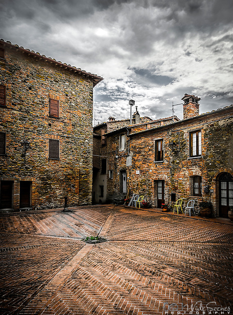 A quiet piazza in the walled town of Panicle in Umbria in Italy
