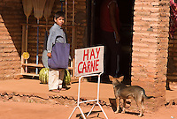 A street dog peers into a small market advertising fresh meat in Santa Maria de Fé (acute accent on the e in Fe), Paraguay. Scores of Jesuit missions in the area where Paraguay, Argentina and Brazil meet were built in the 17th century and abandoned when the Jesuits were expelled in the 18th century. Ruins of some of these missions still haunt hilltops in the region. (Kevin Moloney for the New York Times)