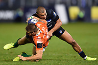 Luca Sperandio of Benetton Rugby is tackled by Jonathan Joseph of Bath Rugby. European Rugby Champions Cup match, between Bath Rugby and Benetton Rugby on October 14, 2017 at the Recreation Ground in Bath, England. Photo by: Patrick Khachfe / Onside Images