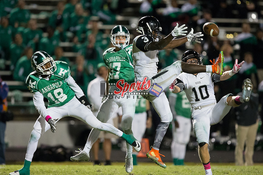 Marquill Osborne (3) and Zack Dudan (10) of the Hough Huskies break up a pass intended for Lewis Harris (18) of the A.L. Brown Wonders during second half action at A.L. Brown High School on October 16, 2015 in Kannapolis, North Carolina.  The Huskies defeated the Wonders 21-7.  (Brian Westerholt/Sports On Film)