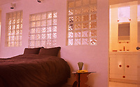 Frank Gehry residence in Santa Monica--bedroom interior. Post-modern with glass blocks.Photo April 2000.