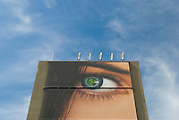 AVAILABLE FROM JEFF AS A FINE ART PRINT.<br /> <br /> AVAILABLE FROM JEFF FOR EDITORIAL LICENSING ONLY INSIDE A PUBLICATION.....NOT AVAILABLE FOR COMMERCIAL/ADVERTISING LICENSING BECAUSE THE IMAGE IS NOT MODEL OR PROPERTY RELEASED<br /> <br /> Advertising Billboard Suspended from Side of a Building and Clouds, New York City, New York State, USA<br /> <br /> FOR EDITORIAL LICENSING ONLY INSIDE A BOOK OR MAGAZINE/NOT AVAILABLE FOR ADVERTISING USE - THE BILLBOARD IS NOT PROPERTY RELEASED.