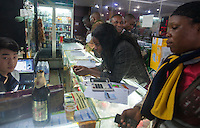 Africans top up their mobile phones at a store run by a Chinese man in an area of Guangzhou known to locals as 'Chocolate City', Guangzhou, Guangdong Province, China, 08 December 2014. The health authorities of Guangzhou are said to be stepping up their monitoring of the African community in light of the ongoing outbreak of the Ebola virus disease in West Africa.