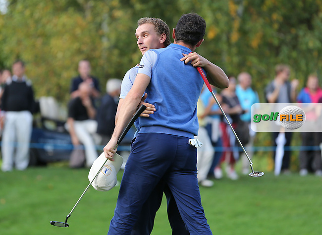 Team Continental Europe's Joost Luiten (NED) and Gregory Bourdy (FRA) shakes hands as they win their match by 2&1 during the Fourball Matches on Day One at the Seve Trophy by Golf+ 2013, from Saint-Nom-La-Breteche, Paris, France. Picture:  David Lloyd / www.golffile.ie