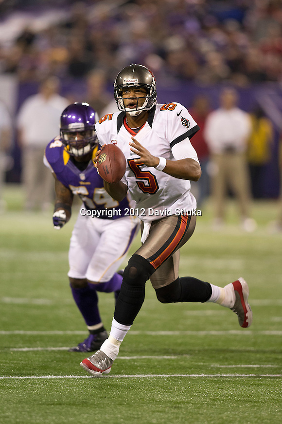 Tampa Bay Buccaneers quarterback Josh Freeman (5) rolls out of the pocket during a Week 8 NFL football game against the Minnesota Vikings Thursday, October 25, 2012 in Minneapolis. The Buccaneers won 36-17. (AP Photo/David Stluka)