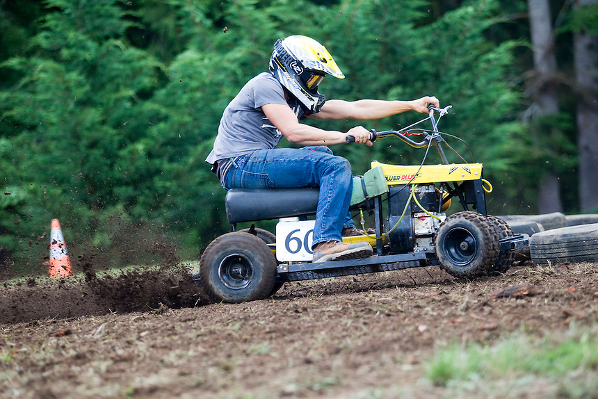 "Chad Kuschel races his his modified lawn-mower at the annual ""Territorial Days"" festival in Amboy Sunday July 10, 2016. Other events during the celebration included a logging show, musical performances, an art show and a carnival. The celebration highlights the area's connection to logging and pioneering. (Photo by Natalie Behring/ for the The Columbian)"