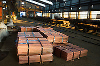 MUFULIRA, ZAMBIA- JULY 7: Batches of copper sheets are stored in a warehouse and wait to be loaded on trucks on July 7, 2016 at Mopani mines, Mufilira, Zambia.  The copper is trucked to ports such as Dar es Salaam, Tanzania & Durban, South Africa. Glencore, an Anglo-Swiss multinational commodity trading and mining company, owns about 73 % of Mopani mines, which produces copper and some cobalt. The mine employs about 15,000 people. Many people in the area are dependent of the mines and its subcontractors for work. (Photo by Per-Anders Pettersson)