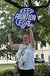 Brandi Denson,26 yrs. old from Louisville Mississippi holds her Keep Abortion Legal sign proudly outside the Mississippi State Capital during a National Organizaton for Woman rally in Jackson  Saturday July 22,2006. NOW is holding a rally in response to Operation Save America that has been protesting all over Jackson, in attempt to close the only abortion clinic in the state of Mississippi. (Photo©Suzi Altman)