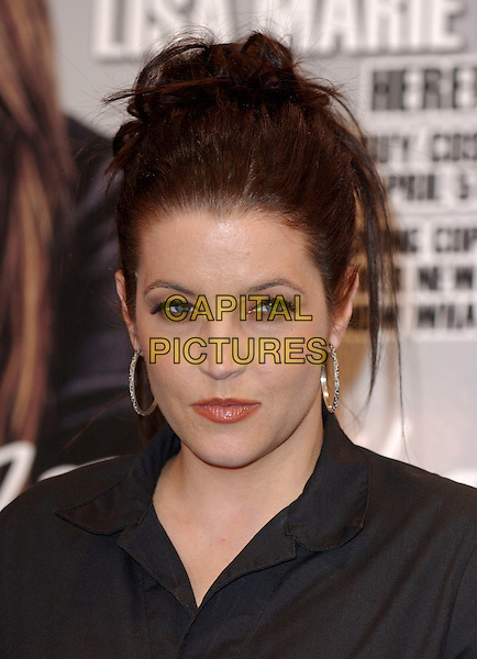 "LISA MARIE PRESLEY.Signs copies of her new CD release, ""Now What"" at Best Buy in Costa Mesa, Los Angeles, California, USA,.April 5th 2005..portrait headshot record signing LA silver hoop earrings.Ref: DVS.www.capitalpictures.com.sales@capitalpictures.com.©Debbie VanStory/Capital Pictures"