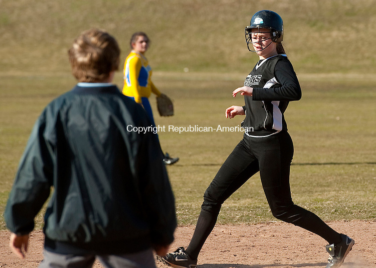 THOMASTON, CT 05 APRIL 2013--040513JS03--Thomaston's Abby Hurlbert (8) makes her way into second base with an RBI double during their game against Gilbert Friday at Thomaston High School. .Jim Shannon Republican-American.