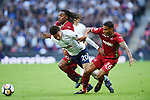 Dele Alli of Tottenham Hotspur is challenged by Kyle Naughton of Swansea City during the premier league match at the Wembley Stadium, London. Picture date 16th September 2017. Picture credit should read: Robin Parker/Sportimage