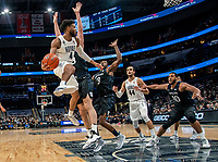 WASHINGTON, DC - JANUARY 28: Jagan Mosely #4 of Georgetown in the air to make a pass during a game between Butler and Georgetown at Capital One Arena on January 28, 2020 in Washington, DC.