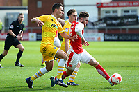 Fleetwood Town's Wes Burns competes with Millwall's Joe Martin (L) and Ben Thompson<br /> <br /> Photographer Richard Martin-Roberts/CameraSport<br /> <br /> The EFL Sky Bet League One - Fleetwood Town v Millwall - Monday 17th April 2017 - Highbury Stadium - Fleetwood<br /> <br /> World Copyright &copy; 2017 CameraSport. All rights reserved. 43 Linden Ave. Countesthorpe. Leicester. England. LE8 5PG - Tel: +44 (0) 116 277 4147 - admin@camerasport.com - www.camerasport.com