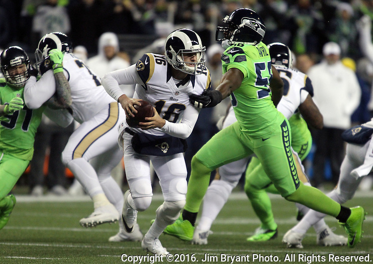Los Angeles Rams quarterback Jared Goff (16) scrambles away from Seattle Seahawks defensive end Cliff Avril (56) at CenturyLink Field in Seattle, Washington on December 15, 2016.  The Seahawks beat the Rams 24-3.   ©2016. Jim Bryant Photo. All Rights Reserved