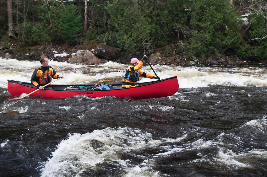 Canoeists run a section of Class II whitewater rapids on the Agawa River of Ontario Canada.