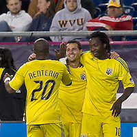 Columbus Crew midfielder Dilly Duka (11) celebrates his goal with teammates.  In a Major League Soccer (MLS) match, the Columbus Crew defeated the New England Revolution, 3-0, at Gillette Stadium on October 15, 2011.