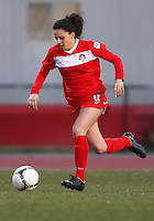 COLLEGE PARK, MARYLAND - April 03, 2013:  Domenica Hodak (4) of The Washington Spirit moves forward against the University of Maryland women's soccer team in a NWSL (National Women's Soccer League) pre season exhibition game at Ludwig Field in College Park Maryland on April 03. Maryland won 2-0.