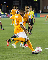 Houston Dynamo defender Jermaine Taylor (4) clears the ball near the Houston goal.  The New England Revolution played to a 1-1 draw against the Houston Dynamo during a Major League Soccer (MLS) match at Gillette Stadium in Foxborough, MA on September 28, 2013.