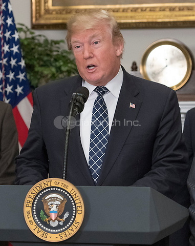 United States President Donald J. Trump makes remarks prior to signing a proclamation to honor Dr. Martin Luther King, Jr. Day in the Roosevelt Room of the White House in Washington, DC on Friday, January 12, 2018. <br /> Credit: Ron Sachs / CNP /MediaPunch