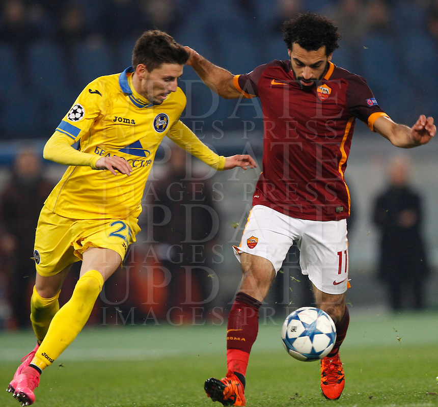 Calcio, Champions League: Gruppo E - Roma vs Bate Borisov. Roma, stadio Olimpico, 9 dicembre 2015.<br /> Roma's Mohamed Salah, right, is challenged by Bate Borisov's Filip Mladenovic during the Champions League Group E football match between Roma and Bate Borisov at Rome's Olympic stadium, 9 December 2015.<br /> UPDATE IMAGES PRESS/Riccardo De Luca