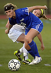 (Worcester Ma 111613) Granby 10, Tara Mikalchus, and Newburyport 5, Georgia Kacher, make a quick spin as the ball bounces away from them in the second half,  during the MIAA State Girls Soccer Division Three final, between Newburyport High and Granby High, Newburyport won the game 1-0, Saturday at Foley Stadium in Worcester. (Jim Michaud Photo) For Sunday
