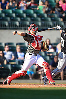 Arkansas Travelers catcher Jett Bandy (27) gets hit by the backswing of Lee Orr (21) during a game against the San Antonio Missions on May 25, 2014 at Dickey-Stephens Park in Little Rock, Arkansas.  Orr was called out on the play for interference.  Arkansas defeated San Antonio 3-1.  (Mike Janes/Four Seam Images)