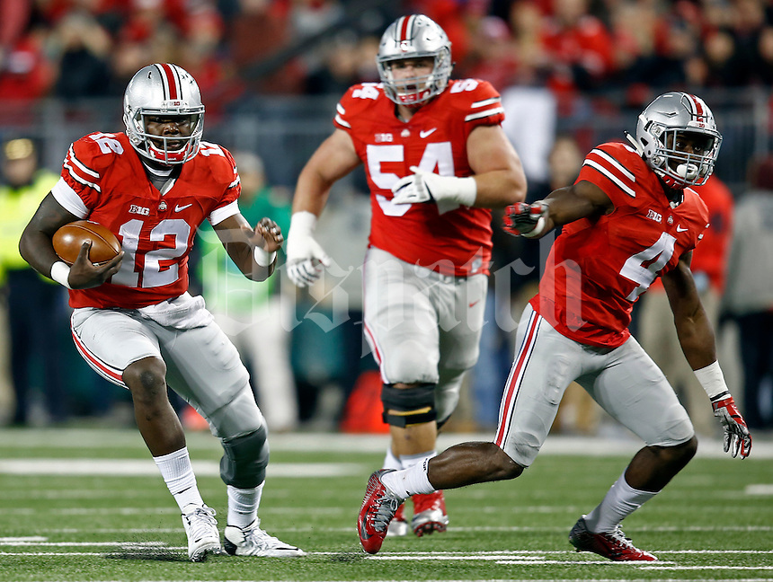 Ohio State Buckeyes quarterback Cardale Jones (12) runs the ball in the second half of the game at Ohio Stadium against the Minnesota Golden Gophers on Saturday, November 7, 2015 in Columbus. (Dispatch photo by Leah Klafczynski)