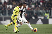 Calcio, Serie A: Juventus - Chievo Verona, Turin, Allianz Stadium, January 21, 2019.<br /> Juventus' Douglas Costa (r) in action with Chievo's Perparim Hetemaj (l) during the Italian Serie A football match between Juventus and Chievo Verona at Torino's Allianz stadium, January 21, 2019.<br /> UPDATE IMAGES PRESS/Isabella Bonotto