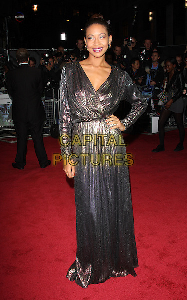 Shanika Warren Markland.UK film premiere of 'Demons Never Die' held at the Odeon West End - Arrivals, London, England..October 10th, 2011.full length silver lame metallic purple silver dress hand on hip wrap.CAP/ROS.©Steve Ross/Capital Pictures