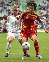 Chile, Temuco: Usa forward Christine Nairn (L) goes for the ball along with Weng Xinzhi Chine´s team, during the final match on the group, Fifa U-20 Womens World Cup the at German Becker stadium in Temuco , on November 26 2008. Photo by Grosnia/ISIphotos.com