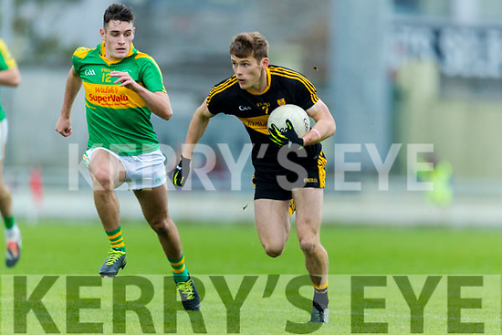 Gavin White Dr Crokes in action against Graham O'Sullivan South Kerry in the Senior County Football Final in Austin Stack Park on Sunday