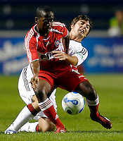 Chicago Fire midfielder Thiago (10) tries to break free from the grasp of DC United defender Facundo Erpen (5).  The Chicago Fire defeated the DC United 3-0 in the semifinals of the U.S. Open Cup at Toyota Park in Bridgeview, IL on September 6, 2006...