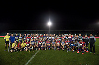 The Bath United and UK Armed Forces teams pose for a photo after the match. Remembrance Rugby match, between Bath United and UK Armed Forces on November 9, 2015 at the Recreation Ground in Bath, England. Photo by: Patrick Khachfe / Onside Images